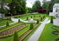 a-fancy-landscaped-park-or-garden-with-flowers-and-highly-groomed